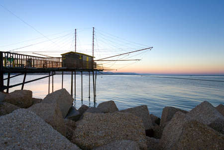 Italy,  Pescara, the traditional fishing equipment colled Trabocco, on the breakwater of the harbor