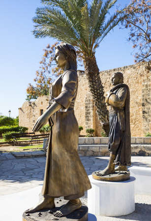 Aya Napa, Greece - November 26, 2016: Cyprus island, statues of local people in traditional dress, in front of the Monastery