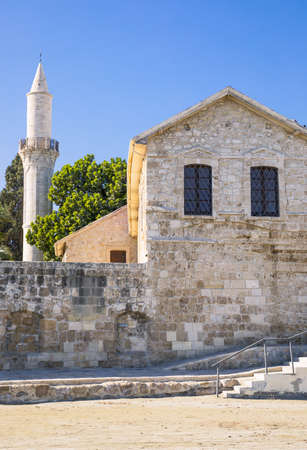 minaret: Creece, Cyprus, Larnaka, a Medieval house with a minaret in the background