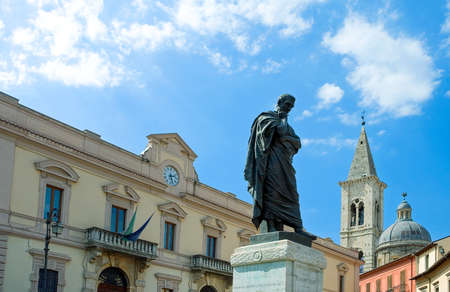 Italy, Sulmona, a typical view of the Ovidius Naso monument in XX Settembre square with the bell tower in the background