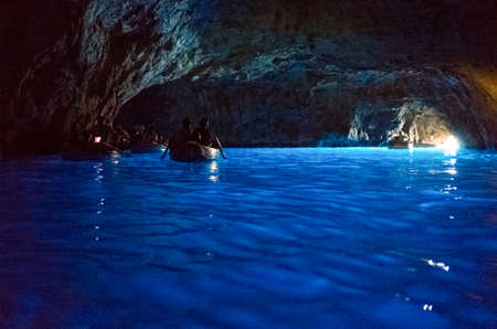 Capri, Italy - August 5, 2015: Boats with tourists in the Blue Grotto Editorial