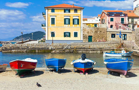 Santa Maria di Castellabate,  Italy - April 7, 2011: Boats in the little harbor Editorial