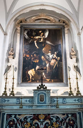 Naples, Italy - August 4, 2015:  A painting by Caravaggio in the Pio Monte Della Misericordia church