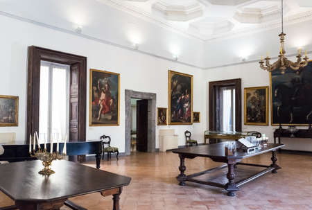 Naples, Italy - August 4, 2015:  Paintings in the halls of the Pio Monte Della Misericordia institution Editorial