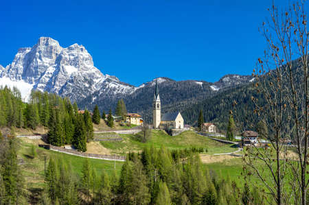 selva: Italy, Dolomites, Selva Di Cadore, the village and in the background the Pelmo mountain Stock Photo