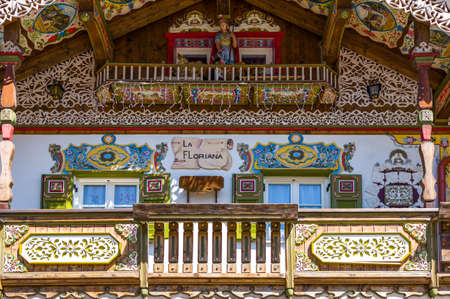 Canazei, Italy - April 26, 2012:  Traditional fully decorated houses in the old village