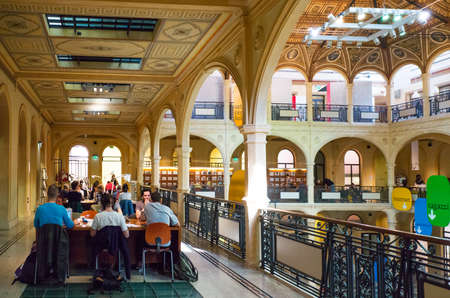 Bologna, Italy - May 4, 2016: People in the Piazza Coperta Library in the ancient Stock Exchange  palace Editorial