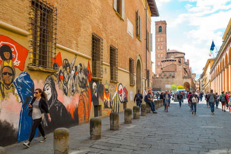 Bologna, Italy - May 5, 2016: Students in the University district with the St.Giacomo Maggiore church in the background