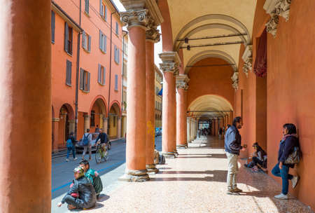 Bologna, Italy - May 5, 2016:  Students under the arcades of the University district Editorial