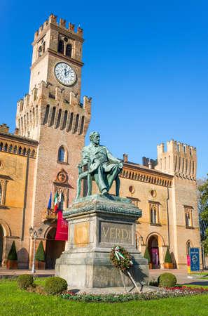Busseto, Italy - November 29, 2013:  The Giuseppe Verdi monument in front of the Pallavicino Rocca