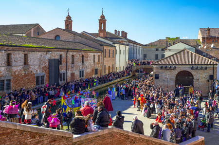 Comacchio, Italy - February 23, 2014:  A crowd of people in the Carnival party on the canals of the country