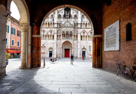 Ferrara, Italy - July 21, 2011: The facade of the Cathedral  seen from the Ducale palace court Editorial