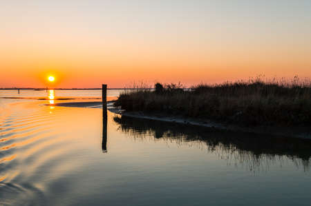 Italy, Po delta park, sunset on the Goro lagoon