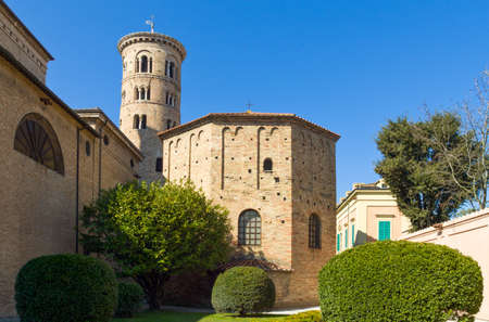Italy, Ravenna, the Battistero Degli Ortodossi (or Neoniano) and, in the background, the Cathedral bell tower.