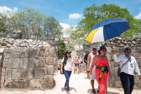 Chichen Itza , Mexico - April 18, 2016: Tourists in the archaeological site,