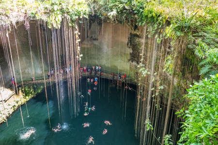 Chichen Itza , Mexico - April 18, 2016: Tourists bathing in the Ik Kil sinkhole