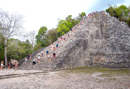 Coba , Mexico - April 20, 2016: Archaeological site, touists climbing the Nohoch Mul pyramid