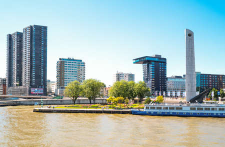 maas: Rotterdam, The Nederlands - July 18, 2016: Modern architectures on the Maas river bank Editorial