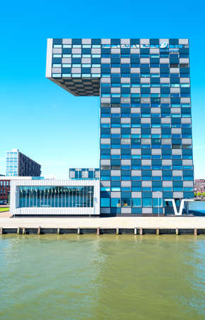 maas: Rotterdam, The Nederlands - July 18, 2016: The modern architectures of the  Shipping and Transport College on the Maas river bank Editorial
