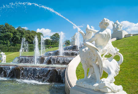Vienna, Austria - August 7, 2016:  A fountain in the garden of the Belvadere Palace Editorial