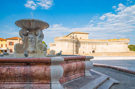 Senigallia, Italy - September 01,2015: The fountain of the Ducks with the Rocca Roveresca  in the background Editorial