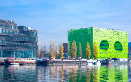 Lyon,  France - December 9, 2016: Confluence district, the Green Cube building on the Saone river bank Editorial