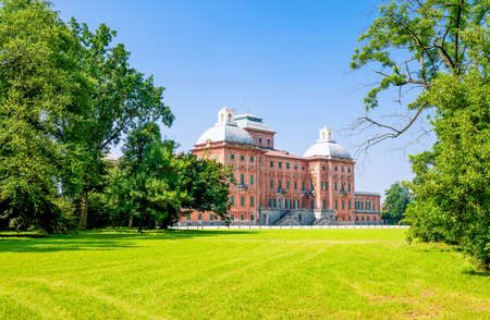 Racconigi, Italy - June 28, 2015:  The Royal castle seen from the park