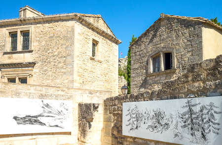 Les Baux De Provence, France - August 26, 2016: Paintings in a courtyard adjacent to the town hall Editorial