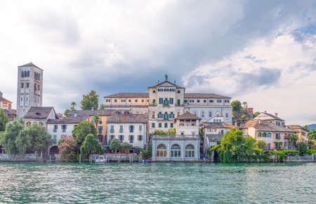 Orta San Giulio, Italy - August 18, 2013:  San Giulio Island, the Bishops Palace and the Basilica