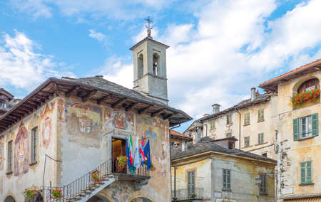 Orta San Giulio, Italy - August 18, 2013: The  Della Comunità medieval palace in Motta square