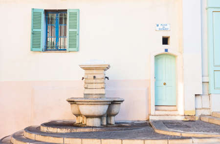Cannes, France - November 21, 2017: The typical colorful houses of Le Sequet old town