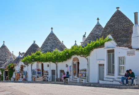 Alberobello, Italy - July 19, 2006: The old country center with the Trulli, rural dwellings of medieval origin made with dry stones and conical roof Editorial