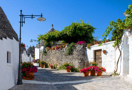Alberobello, Italy, a street with the Trulli, rural dwellings of medieval origin made with dry stones and conical roof