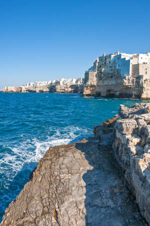 Italy, Polignano, panoramic view of rhe rampants and the white houses of the village over the sea