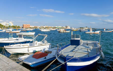Italy, Portocesareo, boats in the fishermen harbor in front of the village