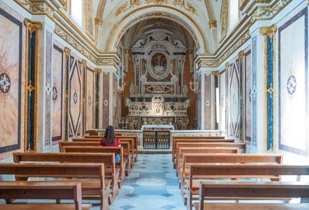 Matera, Italy - may 4, 2017: A lady sitting in a chapel of the Cathedral