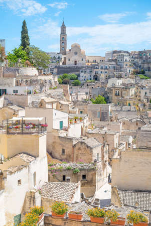 Matera, Italy, the old town of Sassi, former prehistoric troglodyte settlements, seen from the Mater Domini church lookout Stock Photo - 98598624