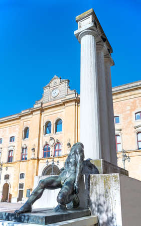 Matera, Italy, V. Veneto square, the war memorial with the old Annunziata convent palace in the background