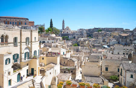 Matera, Italy, the old town of Sassi, prehistoric troglodyte settlements, seen from the Mater Domini church lookout Stock Photo