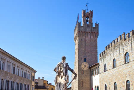 Italy,Tuscany,Arezzo,the Cathedral square with the Town Hall and the Ferdinando Dei Medici statue in the foreground