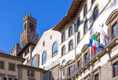 Italy,Tuscany,Florence, the houses of Del Grano square with the Palazzo Vecchio bell tower in the background
