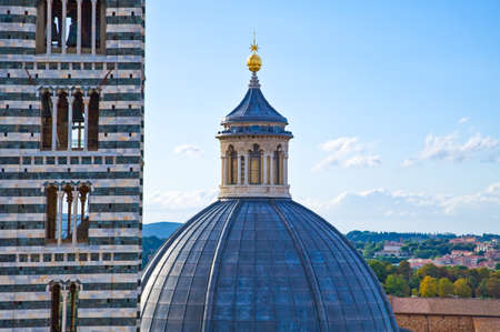 Italy,Tuscany,Siena,view of the Cathedrals bell tower and dome from the Facciatone belvedere