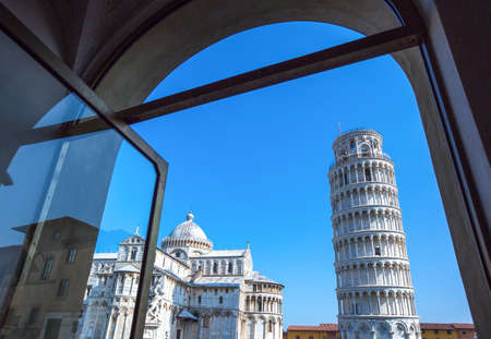Italy, Pisa,  Dei Miracoli square, the Duomo and the Leaning Tower seen from a coffee bar