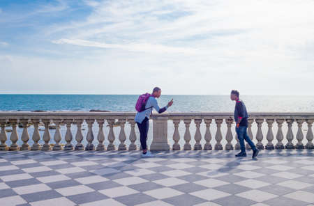 Livorno, Italy -May 26,2016: People in the Mascagni square and lookout on the seafront Editorial