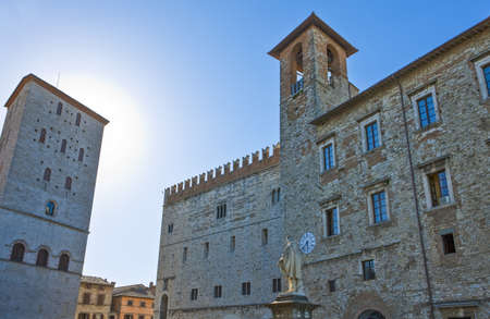 Italy,Umbria,Todi, Garibaldi square,  upward view of the medieval  buildings with the  Giuseppe Garibaldi monument in the foreground Stock Photo