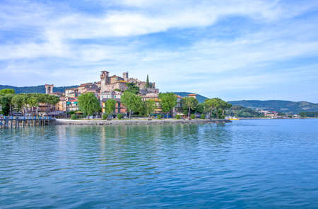 Italy, Passignano Sul Trasimeno, view of the village from the lake