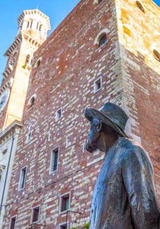 Verona, Italy - December 7, 2013:  The Barbarani statue in  Delle Erbe square