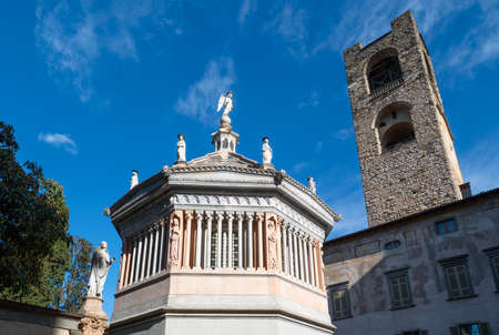 The Baptistery next to the S.Maria Maggiore basilica with the Civic tower in the background, Bergamo, Italy