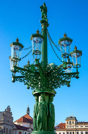 Prague, Czech Republic, Castle district, a sumptuous lamp post in the Castle square in front of the Archbishop palace 스톡 콘텐츠