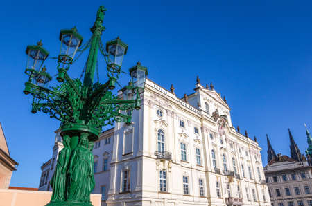 Prague, Czech Republic, Castle district, a sumptuous lamp post in the Castle square in front of the Archbishop palace 에디토리얼